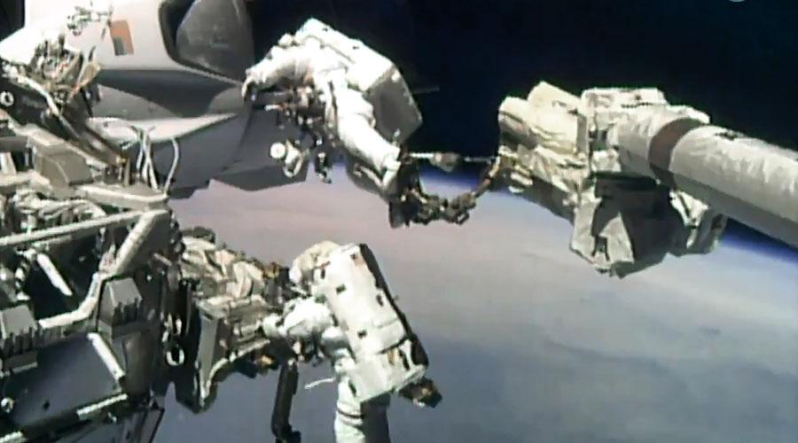 NASA astronauts conduct spacewalk to upgrade ISS