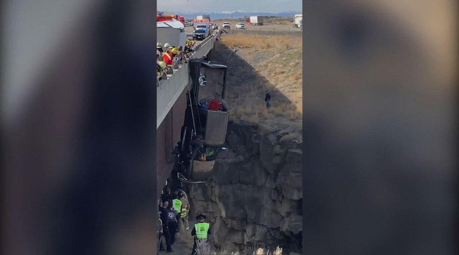 Two rescued from truck dangling over Idaho bridge – video