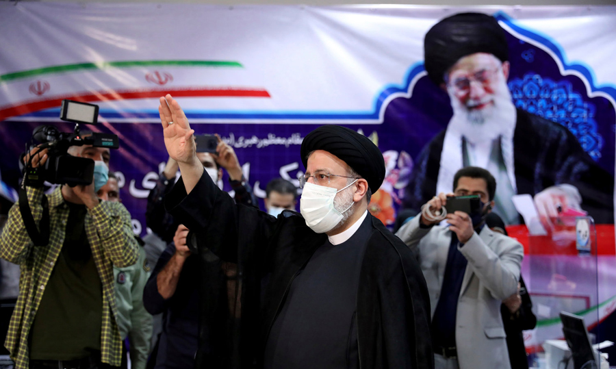 Iranians vote in an all but decided presidential election