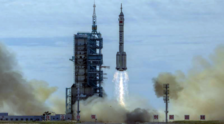 China launches three astronauts into orbit