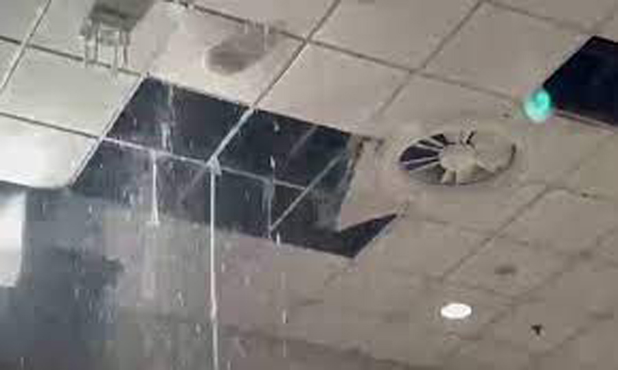 Rainwater pours down at Islamabad airport as false ceilings collapse